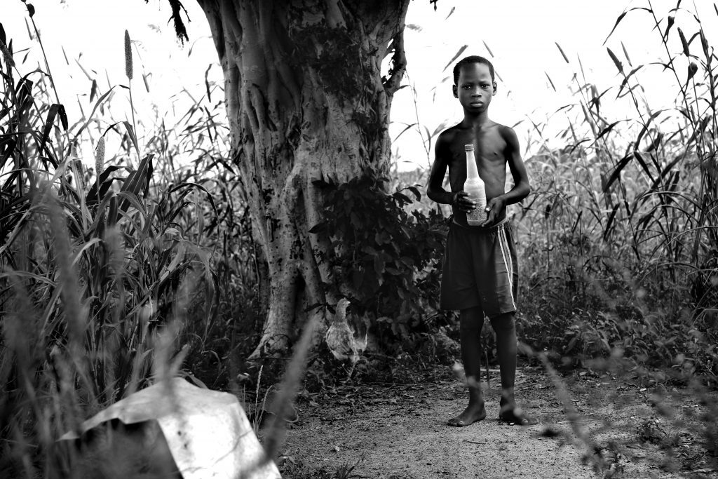 Boy and Chicken - Ghana